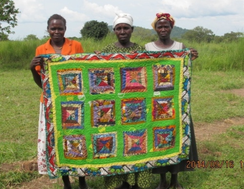 We  call this the Congo Log quilt. The women cut and design the squares themselves.